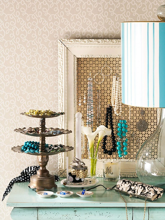 Use a photo frame or board to display jewelry.